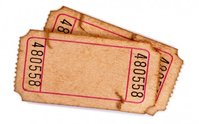 Pair of old torn blank raffle tickets on a white background.