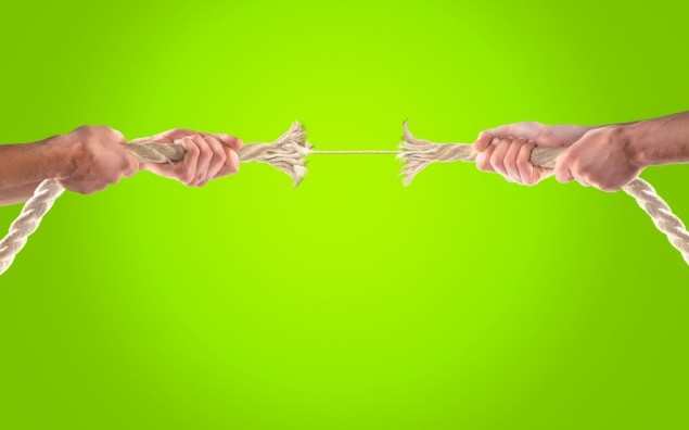 Hands of people pulling the rope. Cooperation concept