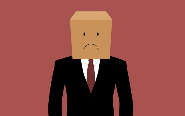 Cardboard businessman with an unhappy face