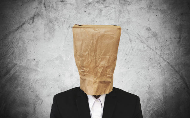 Businessman with brown paper bag on head, with copy space
