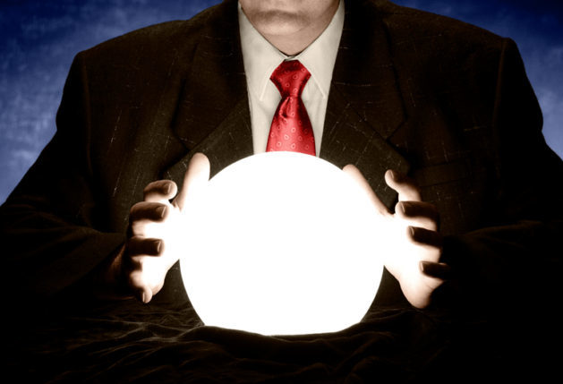 Businessman with Red Tie Consulting Glowing Crystal Ball