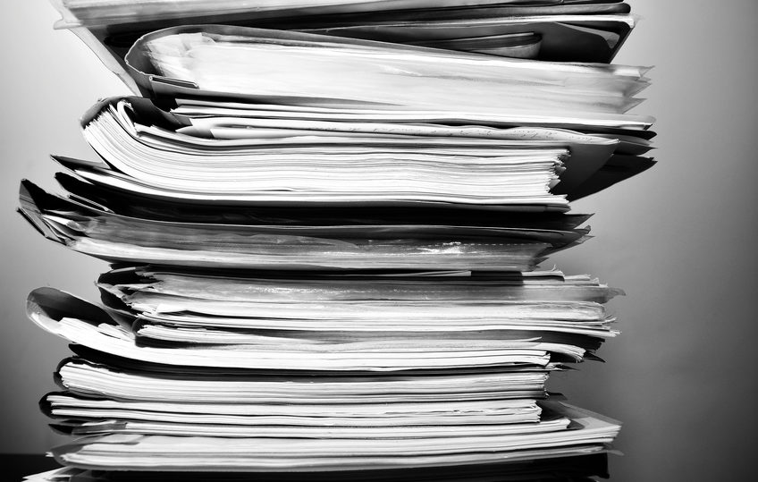 Stack of files on his desk